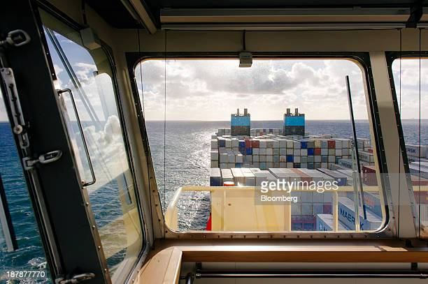 Shipping containers sit aboard the Maersk McKinney Moeller TripleE Class container ship operated by AP MoellerMaersk A/S as it sails on the North Sea...