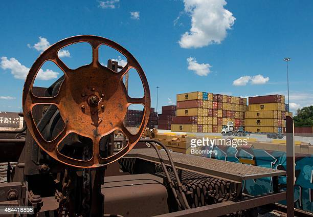 Shipping containers sit before being loaded onto rail cars at the Port of Savannah in Savannah Georgia US on Friday Aug 14 2015 The trade deficit in...