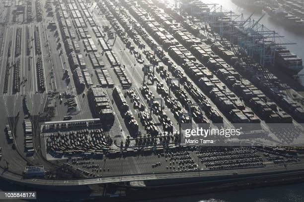 Shipping containers sit near cargo ships at the Port of Los Angeles the nation's busiest container port on September 18 2018 in San Pedro California...