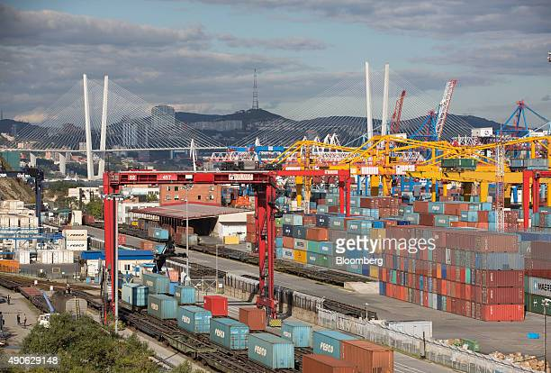 Shipping containers sit on freight wagons beside the dock storage area at the Commercial Port of Vladivostok in Vladivostok Russia on Saturday Sept...