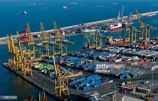 Shipping containers sit on the dockside at Barcelona port in Barcelona Spain on Monday June 10 2013 Economic confidence in the euro area increased in...