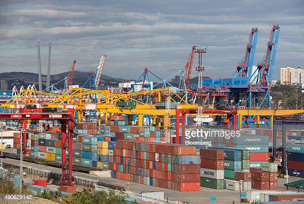 Shipping containers sit on the dockside at the Commercial Port of Vladivostok in Vladivostok Russia on Saturday Sept 26 2015 'It is simply impossible...