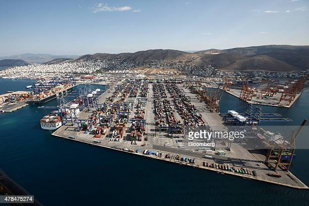 Shipping containers sit on the dockside in the COSCO Pacific Ltd terminal at Piraeus port operated by Piraeus Container Terminal SA in Athens Greece...