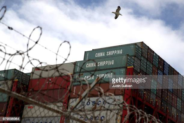 Shipping containers sit on the the Hong Kong based CSCL East China Sea container ship at the Port of Oakland on June 20, 2018 in Oakland, California....