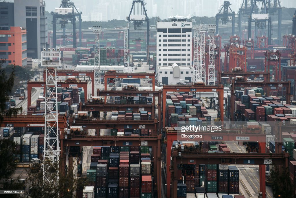 Shipping containers sit stacked among gantry canes at the Kwai Tsing Container Terminals, operated by Hong Kong International Terminal (HIT), a unit of CK Hutchison Holdings Ltd., in Hong Kong, China, on Friday, March 17, 2017. CK Hutchison is scheduled to release earnings results on March 22. Photographer: Anthony Kwan/Bloomberg via Getty Images