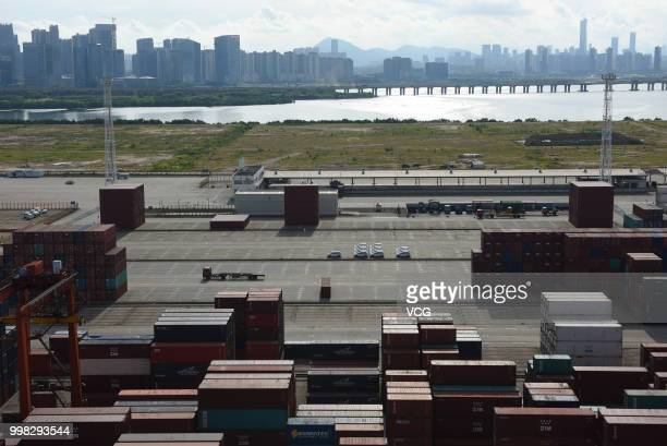 Shipping containers sit stacked at Dachan Bay Terminals on July 12 2018 in Shenzhen Guangdong Province of China The US government threated to impose...