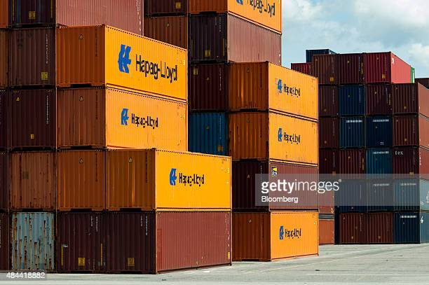 Shipping containers sit stacked at the Port of Savannah in Savannah Georgia US on Friday Aug 14 2015 The trade deficit in the US widened in June as...