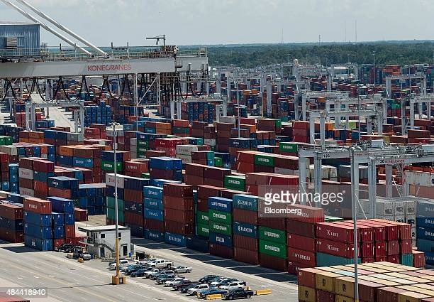 Shipping containers sit stacked at the Port of Savannah in Savannah, Georgia, U.S., on Friday, Aug. 14, 2015. The trade deficit in the U.S. Widened...