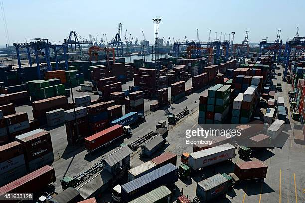 Shipping containers sit stacked at the Tanjung Priok port, operated by state-owned PT Pelabuhan Indonesia II , in Jakarta, Indonesia, on Tuesday,...