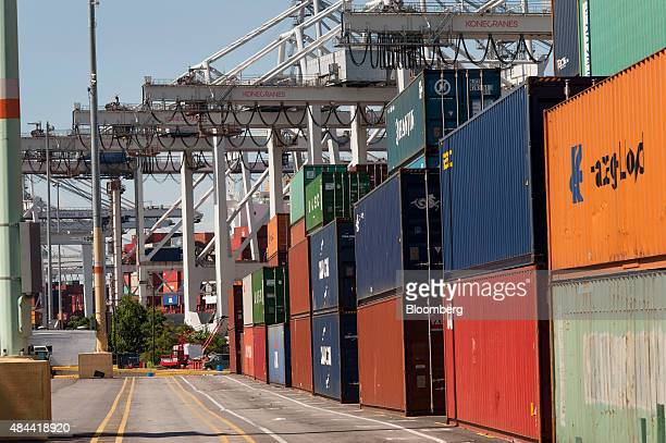 Shipping containers sit stacked before being loaded onto ships at the Port of Savannah in Savannah Georgia US on Friday Aug 14 2015 The trade deficit...