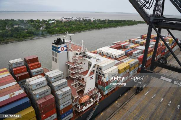 Shipping containers sit stacked on a cargo ship docked at the Port of Houston Bayport Container Terminal in Pasadena Texas US on Friday April 12 2019...