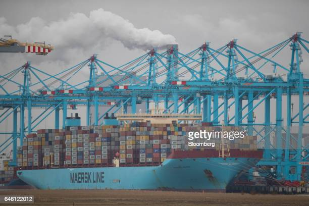Shipping containers sit stacked on the container ship Maglebi Maersk operated by AP MollerMaersk A/S as she sits docked at the RWG container terminal...