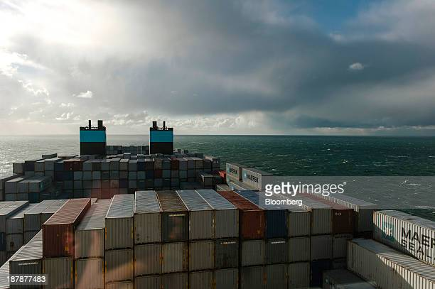 Shipping containers stand aboard the Maersk McKinney Moeller TripleE Class container ship operated by AP MoellerMaersk A/S as it sails across the...