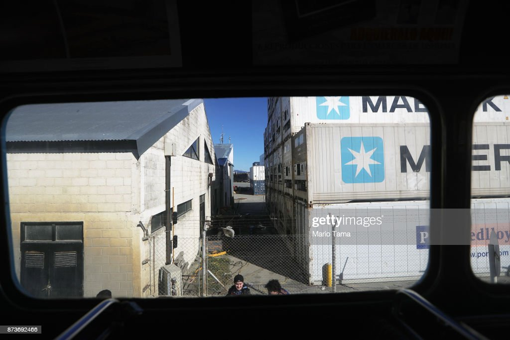 Shipping containers (R) stand along the docks, as viewed from the window of a vintage London Routemaster bus, used for tourist tours, on November 5, 2017 in Ushuaia, Argentina. Ushuaia is situated along the southern edge of Tierra del Fuego, in the Patagonia region, and is commonly known as the 'southernmost city in the world'. The city's main fresh water supply comes from the retreating Martial Glacier, which may be at risk of disappearing. In a 2015 report, warming temperatures led to the loss of 20 percent of the mass and surface of glaciers in Argentina over the previous 50 years, according to Argentina's Institute of Nivology, Glaciology and Environmental Sciences (IANIGLIA). Ushuaia and surrounding Tierra del Fuego face other environmental challenges including a population boom leading to housing challenges following an incentivized program attracting workers from around Argentina. Population in the region increased 11-fold between 1970 and 2015 to around 150,000. An influx of cruise ship tourists and crew, many on their way to Antarctica, has also led to increased waste and pollution in the area sometimes referred to as 'the end of the world'.