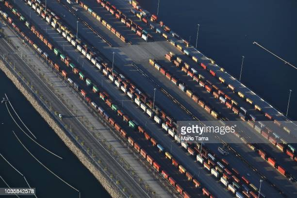 Shipping containers stand mounted onto trains at the Port of Los Angeles the nation's busiest container port on September 18 2018 in San Pedro...