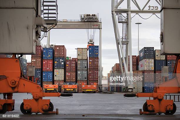 Shipping containers stand on the dockside at the Delta Terminal operated by Europe Container Terminals BV at the Port of Rotterdam in Rotterdam...