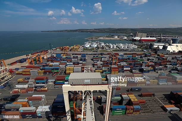 Shipping containers stand on the dockside in this aerial view at the port of Koper operated by Luka Koper dd in Koper Slovenia on Thursday May 9 2013...