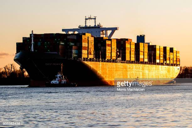 Shipping containers stand stacked on a container ship as it arrives at the Hamburg port Germany's biggest international trade port on March 20 2018...