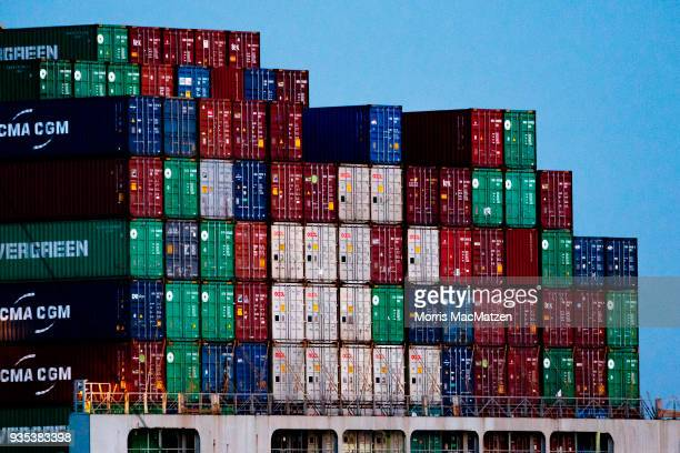 Shipping containers stand stacked on a container ship as it leaves the Hamburg port, Germany's biggest international trade port, on March 20, 2018 in...