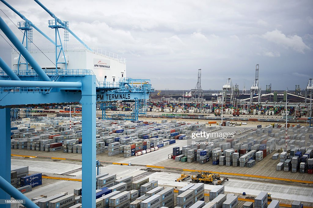Shipping containers stand stacked on the dockside at the Port of Rotterdam seen from the deck of the Maersk Mc-Kinney Moeller Triple-E Class container ship, operated by A.P. Moeller-Maersk A/S, in Rotterdam, Netherlands, on Monday, Nov. 11, 2013. A.P. Moeller-Maersk A/S's container-shipping line, the world's largest, reported an 11 percent increase in third-quarter profit after cost cuts countered a decline in freight rates. Photographer: Kristian Helgesen/Bloomberg via Getty Images