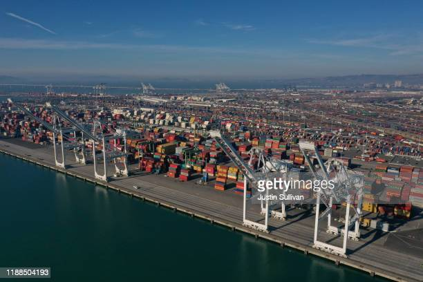 Shipping cranes sit idle at the Port of Oakland on November 18, 2019 in Oakland, California. The World Trade Organization says that global flows of...