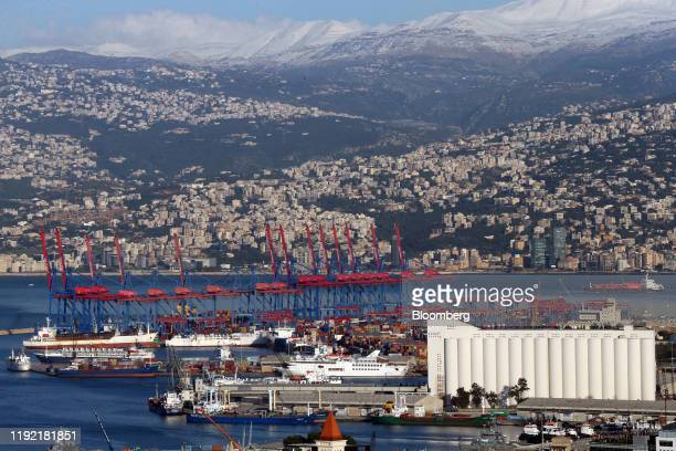 Shipping cranes stand at the Port of Beirut as residential and commercial property at the base of Mount Lebanon mountain range in Beirut, Lebanon, on...
