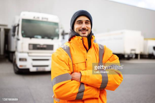 shipping yard worker standing outdoors - hat stock pictures, royalty-free photos & images