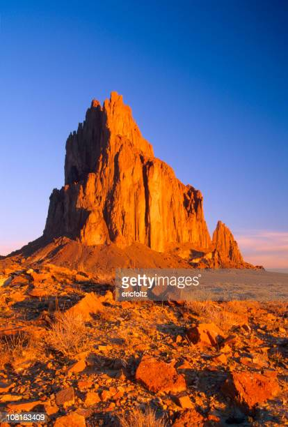 shiprock in desert against blue sky - shiprock stock photos and pictures