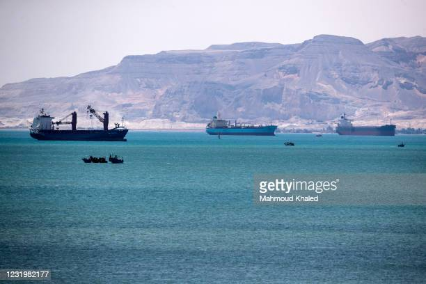 Ships and boats are seen at the entrance of Suez Canal on March 28, 2021 in Suez, Egypt. Work continues to free the Ever Given, a huge container ship...