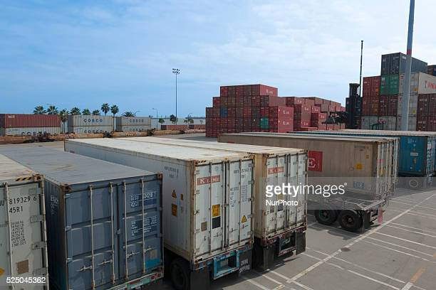 Ships and containers wait to be put back to use after a long ILWU labor dispute stopped work at the port of Long Beach CA Feb 21 2015
