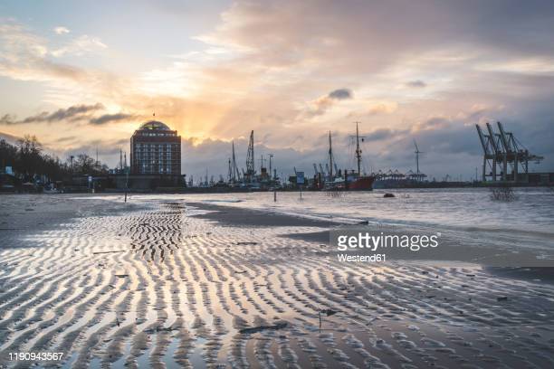 ships and cranes at harbor against cloudy sky during sunset, hamburg, germany - エルベ川 ストックフォトと画像