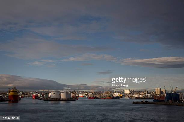 Ships and oil storage silos stand on the dockside at Aberdeen Harbour operated by the Aberdeen Harbour Board in Aberdeen UK on Thursday Dec 12 2013 A...