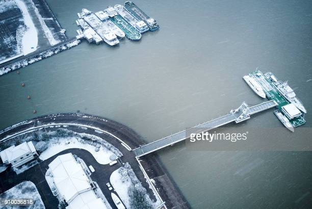 Ships are moored at the Yangtze River in this aerial view after snowfall in Nantong in China's eastern Jiangsu province on January 25 2018 / AFP...