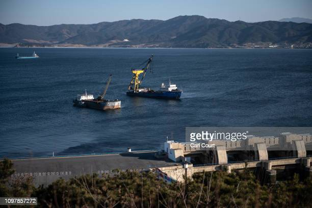 Ships are moored next to the eight kilometre long West Sea Barrage, a system of dams, lock chambers, and sluices that close off the Taedong River...