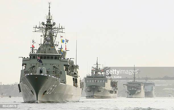 Ships are seen in Sydney Harbour after entering through the Sydney heads during a ceremonial exercise involving The Royal Australian Navy's Fleet...