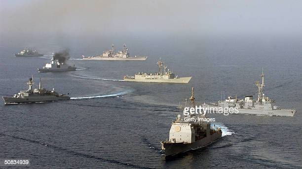 Ships assigned to Combined Task Force One Five Zero assemble in a formation for a photo exercise in this photo released May 13 in the Gulf of Oman...