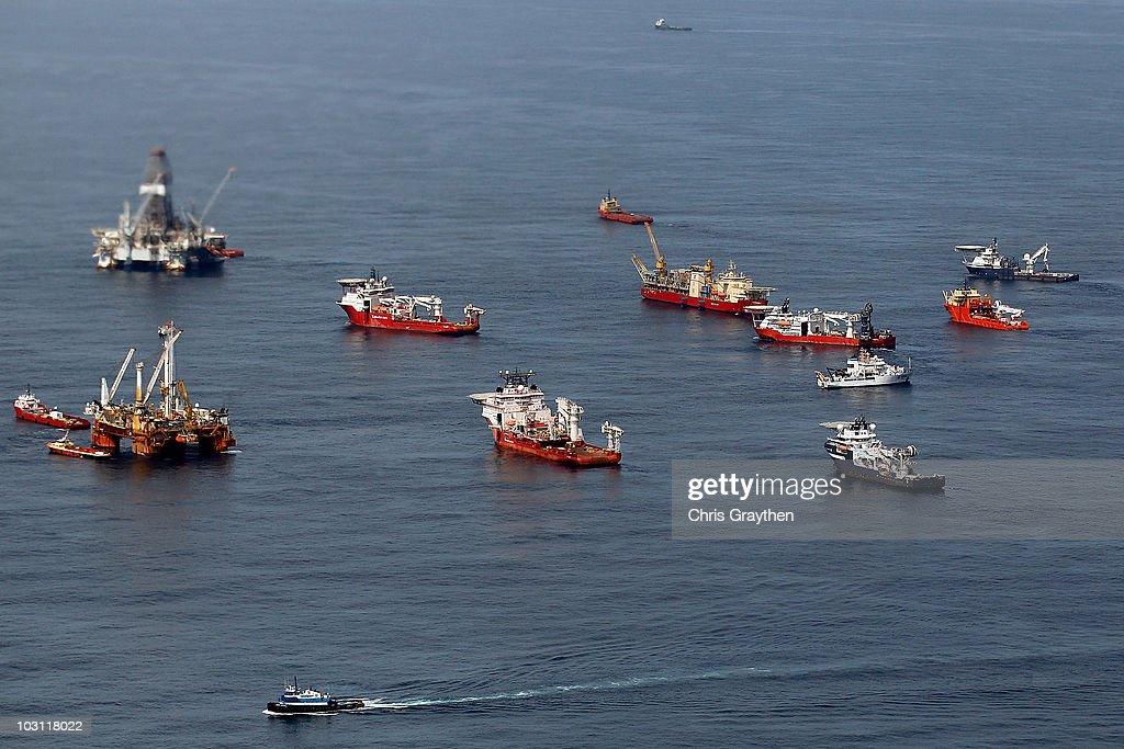 Ships assist in clean up and containment near the source of the BP Deepwater Horizon oil spill July 27, 2010 in the Gulf of Mexico off the coast of Louisiana. Work continues to put a permanent plug on the well which has leaked an estimated three to five million barrels of oil.