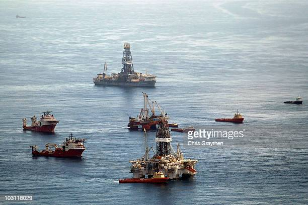 Ships assist in clean up and containment near the source of the BP Deepwater Horizon oil spill July 27 2010 in the Gulf of Mexico off the coast of...