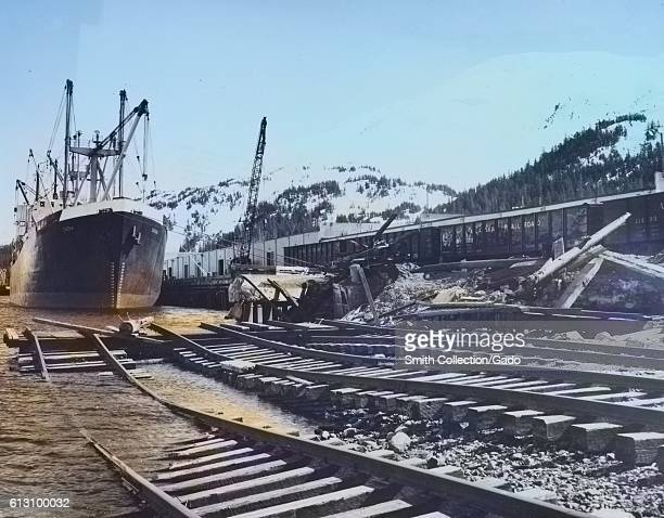 Ships at docks and railroad tracks in the water following an earthquake in Whittier Alaska March 1964 Note Image has been digitally colorized using a...