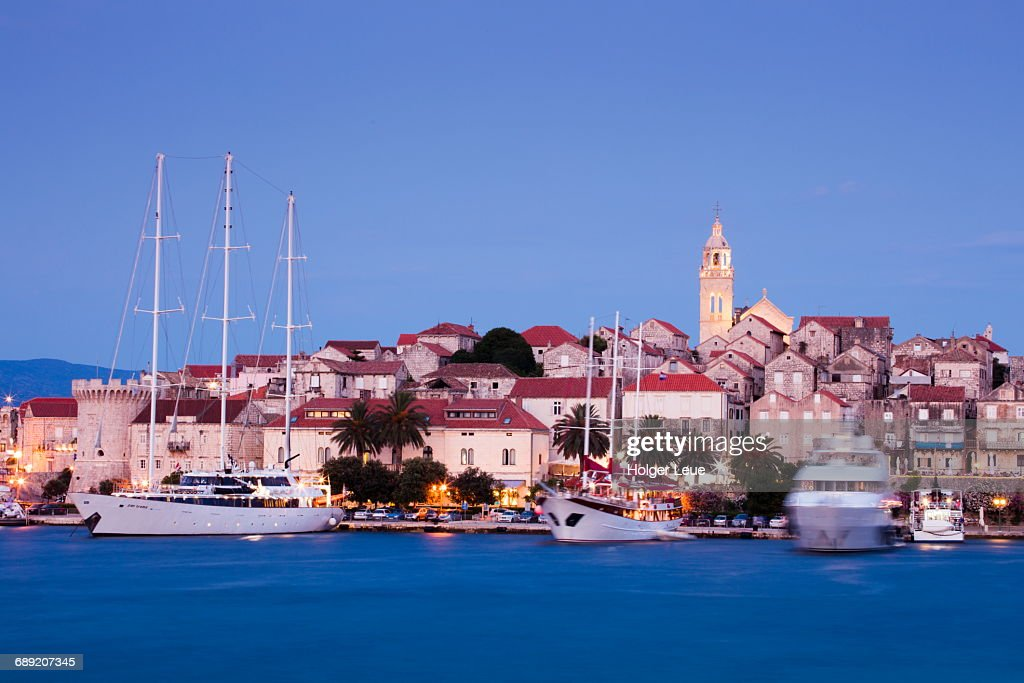 Ships at pier, Old Town and cathedral at dusk : Stock Photo