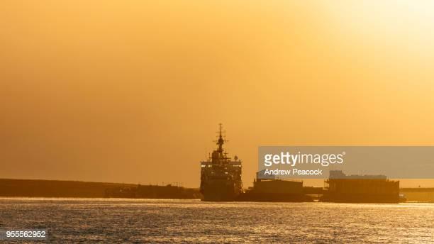 Ships at the dock at sunset