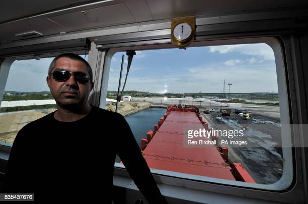 Ships captain Andrey Semenov is pictured in the wheel room of the OMG Kolpino Russian cargo ship which is moored at Avonmouth docks Bristol The crew...