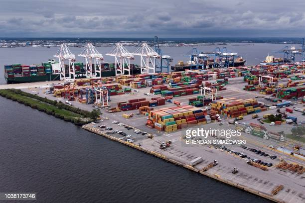 Ships cargo containers and tractor trailers are seen at the Seagirt Marine Terminal in the Port of Baltimore on September 21 in Baltimore Maryland...