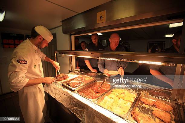 Ships cooks prepare meals for sailors in the galley of HMS Ark Royal during Exercise Auriga on July 14 2010 at sea in Onslow Bay near North Carolina...