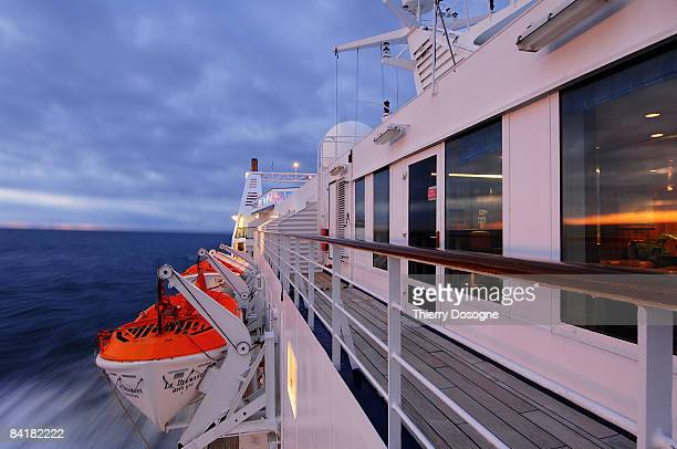 ship's deck in sunrise,  - lifeboat stock pictures, royalty-free photos & images