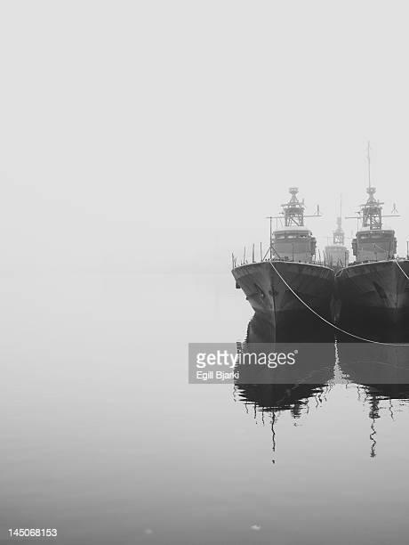 Ships docked in still harbor