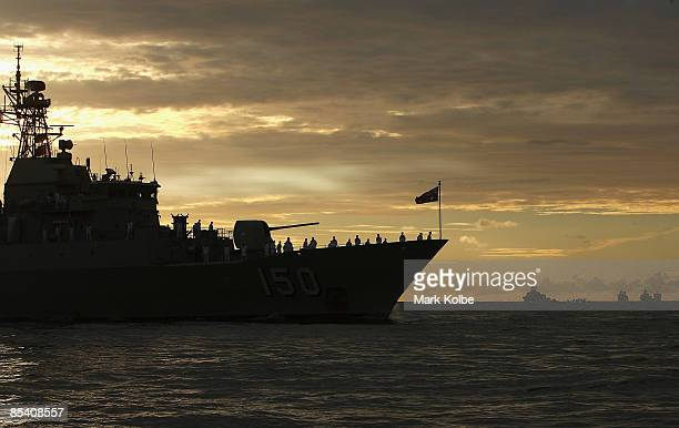 Ships entering through the Sydney heads are seen during a ceremonial exercise involving The Royal Australian Navy's Fleet Entry, Fleet Air Arm and...