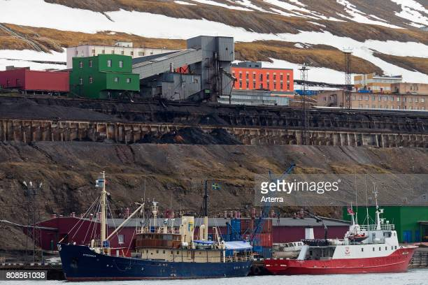 Ships for ecotourism in the harbour of Barentsburg Russian coal mining settlement at Isfjorden Spitsbergen / Svalbard Norway