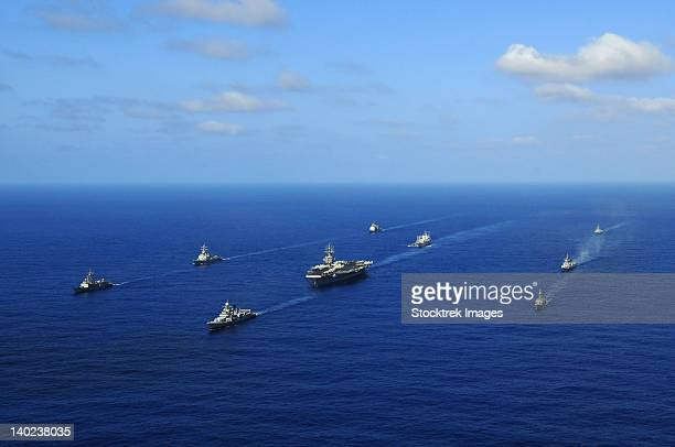 Ships from the Ronald Reagan Carrier Strike Group transit the Pacific Ocean.