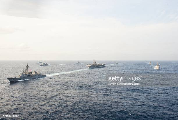 Ships from the USS George Washington Carrier Strike Group the Japanese Maritime SelfDefense Force and the Republic of Korea navy are underway during...